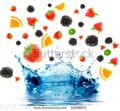 stock-photo-berry-and-fruit-falling-in-juice-isolation-19288075